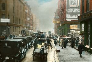 STREETSCAPE: In this colorized image taken circa 1910, a Chicago police officer directs traffic – human, automobile, and equestrian – at a busy South Water Street intersection.