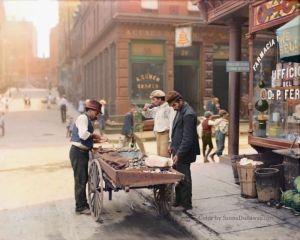 STREET COMMERCE: A clam seller does some business in Little Italy, New York City. c. 1900-1905